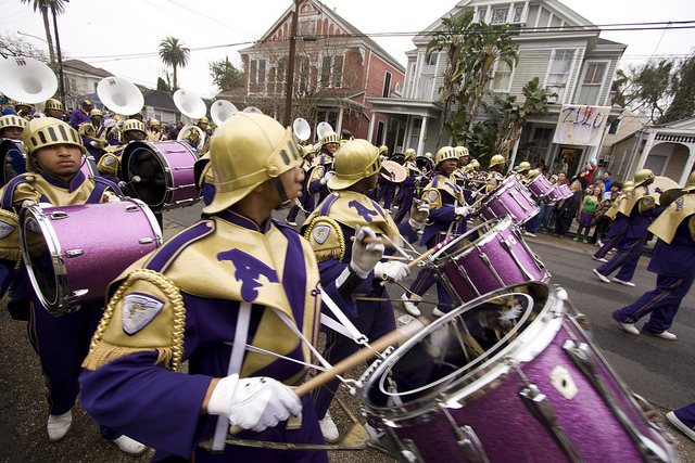 "High school marching bands are a mainstay at Mardi Gras parades, and the St. Augustine High School ""Marching 100"" is always a crowd favorite. (Photo courtesy Flickr user Derek Bridges)"