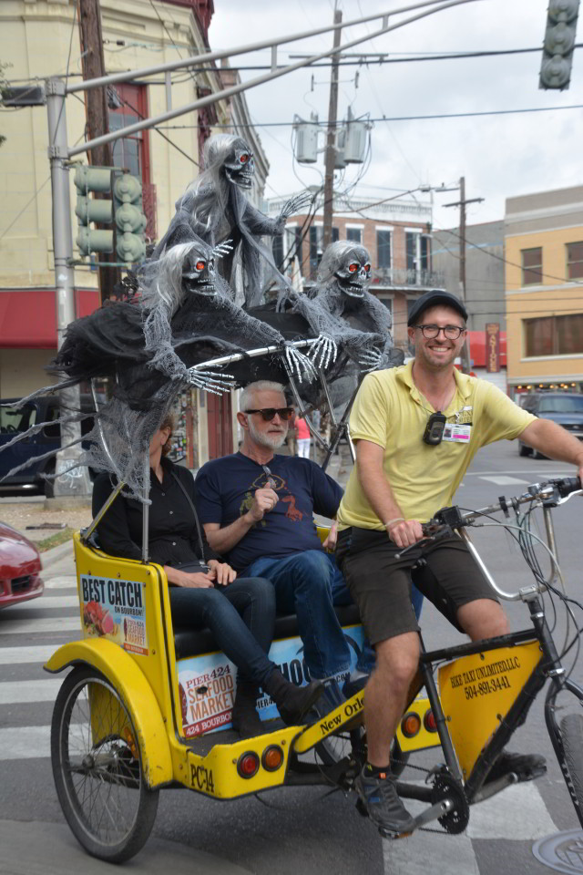 Like most New Orleanians, pedicab drivers are a fun loving bunch. (Photo courtesy Flickr user John Rigney.)