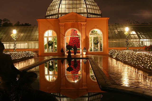 Christmas in the Oaks is kid-friendly but also romantic. Here, the Botanical Garden greenhouse is drenched in light and holiday decor. (Photo courtesy Justin McGregor on Flickr)
