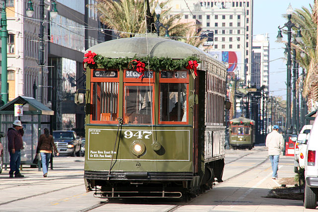 At night Canal Street features twinkling holiday lights. By day the streetcars are adorned with holiday decorations. (Photo courtesy Robert Kaufmann)