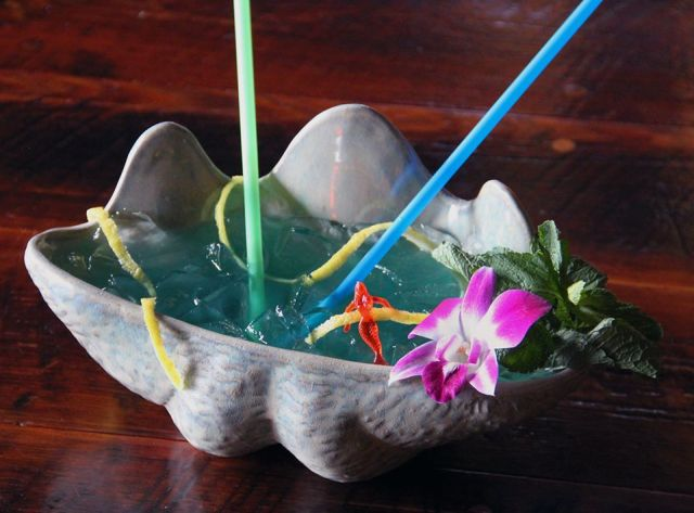 What's big and blue and is served in a clam shell? It's called the Aquadesiac, it's built for 2 and it's served at our in-house tiki bar, Latitude 29.