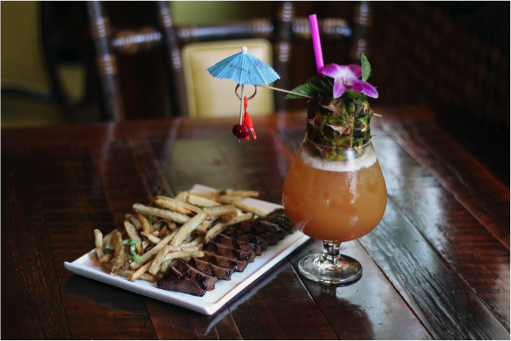 steak fries and a tropical cocktail from Latitude 29 at Bienville House Hotel in New Orleans