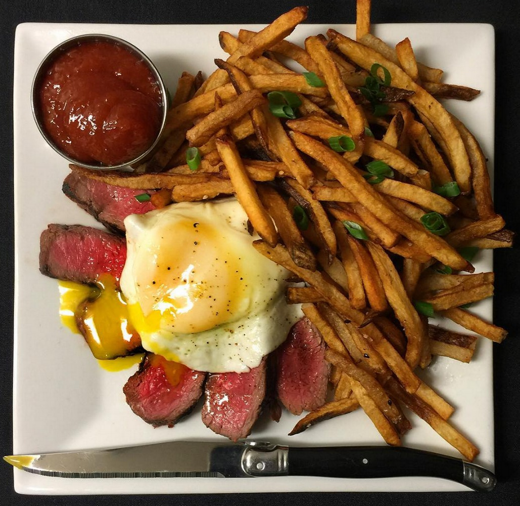 Tahitian Steak Frites with a fried egg on top at Latitude 29. (Photo via Latitude 29 on Instagram)