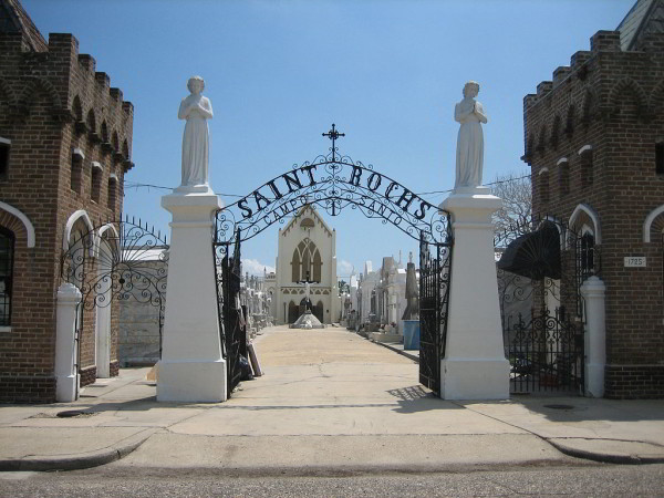 Entrance arch to St. Roch Cemetery, New Orleans (Photo by Infrogmation, via Wikimedia Commons)
